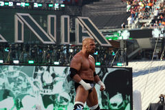 Triple H stands on top of turnbuckles looking out into crowd bef Stock Photography