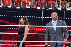 Triple H and Stephanie McMahon smile in the middle of the ring Royalty Free Stock Images