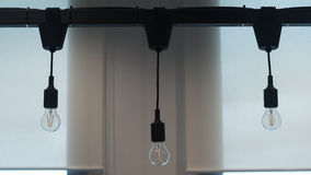 Triple of hanged down light off lamp on beam in the office. S Royalty Free Stock Photo