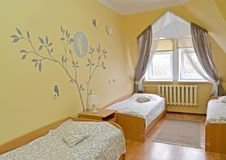The triple hotel room with a portrait of the Russian poet Sergey Yesenin on a wall.  Stock Photos