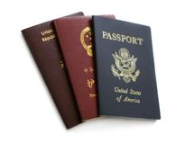 Triple Identity. French, Chinese and US Passports Royalty Free Stock Image