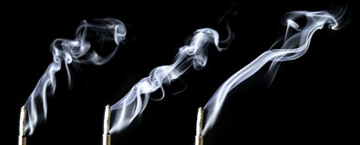 Triple incense smoke Stock Images