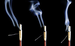 Triple incense smoke Royalty Free Stock Images