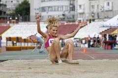 Triple jump athlete. Female athlete performing during triple jump discipline at Romanian International Atheltics Championship, Stefan cel Mare Stadium, Bucharest Stock Photography