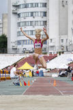 Triple jump athlete. Female athlete performing during triple jump discipline at Romanian International Atheltics Championship, Stefan cel Mare Stadium, Bucharest Royalty Free Stock Image
