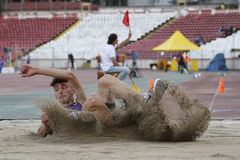 Triple jump athlete Stock Image