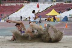 Triple jump athlete. Male athlete performing during triple jump discipline at Romanian International Atheltics Championship, Stefan cel Mare Stadium, Bucharest Stock Image