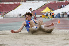 Triple jump athlete Stock Images