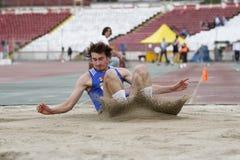 Triple jump athlete. Male athlete performing during triple jump discipline at Romanian International Atheltics Championship, Stefan cel Mare Stadium, Bucharest Stock Images