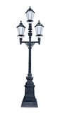 Triple lamppost. An isolated photo of an old lamppost in Saint-Petersburg, Russia Royalty Free Stock Photo