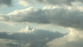 Triple Layered Cloudscape. Static medium wide slow motion time lapse shot of a triple layered cumulus cloudscape, during a sunny cloudy day stock footage