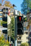 A triple pedestrian traffic light, Lucerne, Switzerland. A triple pedestrian traffic light with a burning red man signifying a stop sign, Lucerne, Switzerland Royalty Free Stock Photography