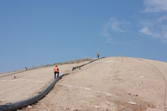 Triple pipe working men Stock Photography