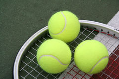 Triple Play. Tennis Balls royalty free stock image