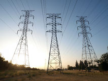 Triple Power Towers. Three power towers at sunrise in smoggy Southern California Stock Images
