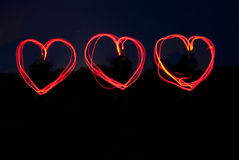 Triple Red Hearts Shining in the Night. Stock Photos