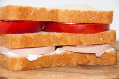 Triple sandwich with salami tomato and sour cream Stock Photography