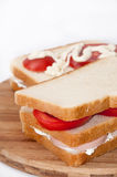 Triple sandwich with salami tomato and sour cream Stock Photos
