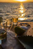 Triple shots of tequila by the sea Royalty Free Stock Photos
