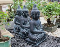 Triple Spirituality. The more Buddhas, the more spirituality :::   Statues of Buddha in a garden shop Stock Images
