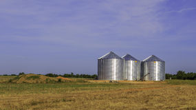 Triple Stainless Steel Grain Silo royalty free stock photography