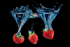 Triple strawberry splash Stock Photography