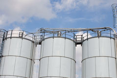 Triple Tanks. Factory fuel storage tanks with blue sky background Royalty Free Stock Photo