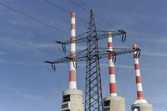 Triplet industrial chimney. At a power station with power pole Royalty Free Stock Images