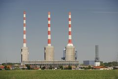 Triplet industrial chimney. At a power station Stock Photo