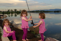 Triplets at the lake Stock Photos