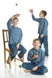 Tripletti Yo-yoing Fotografia Stock Libera da Diritti