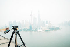 Tripod on the background of modern city Stock Photos