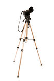 Tripod and camera isolated. On the white background Royalty Free Stock Image