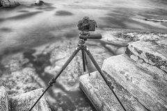 A tripod and camera on stone steps Royalty Free Stock Images