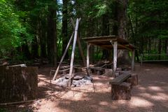 Tripod Cooking Camp Fire Ring. A wood-fueled cooking area in Lewis and Clark National Historical Park in Clatsop County, Oregon, USA stock images