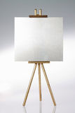 Tripod, easel and blank space. Tripod, easel and blank space, on a white background Royalty Free Stock Image
