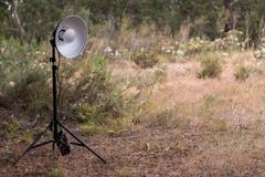 Tripod with flash head. On a beauty dish in nature Stock Images