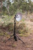 Tripod with flash head. On a beauty dish in nature Royalty Free Stock Image