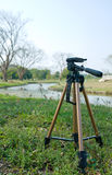 Tripod on natural scene. Portrait of tripod on natural scene. abstract of the traveller and photographer Royalty Free Stock Image