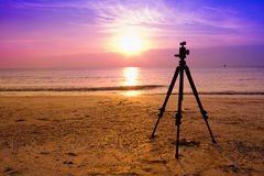 Tripod over sun rising Royalty Free Stock Image
