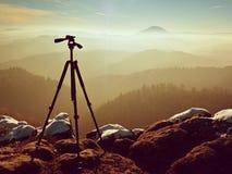 Tripod on peak ready for photography. Sharp autumn mountains Stock Photo
