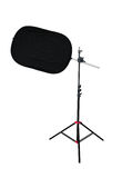 Tripod with studio light reflector Royalty Free Stock Photo