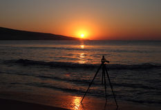 Tripod on the sunrise over black sea Stock Images