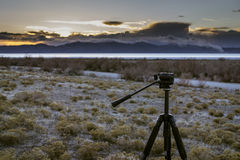 Tripod and sunset over the Great Salt Lake. A tripod in the foreground while the sun sets over the mountains Stock Photo