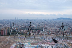 Tripods on a hill with a panoramic view of Barcelona. Photographers taking a break. Overview of the Spanish city of Barcelona on a cloudy day Royalty Free Stock Image