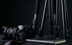 Tripods,notebook,pen and camera. Ready for filming or photo session. Photography equipment Stock Photos