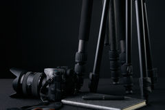Tripods,notebook,pen and camera. Ready for filming or photo session. Photography equipment Royalty Free Stock Photos