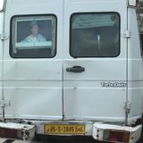 Gheddafi picture in a van. Tripoli, Lybia - May 02, 2002: Gheddafi picture in a van window Stock Photo