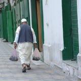 Man walking in the street. Tripoli, Lybia - May 02, 2002: Man walking in the streets of tripoli Royalty Free Stock Image