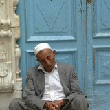 Men sleeping in Tripoli. Tripoli, Lybia - May 02, 2002: Men resting in Tripoli suq Royalty Free Stock Photos